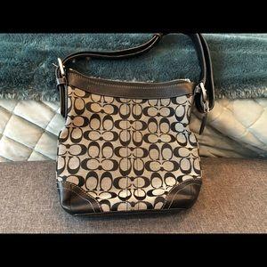 Black Coach signature crossbody purse